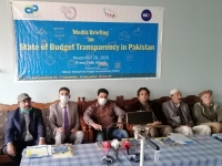 Raja-Noabahar-Chairman-and-Mir-Manzar-GS-of-CRG-sitting-along-with-CPDI-budget-coordinator-Faisal-Munir-paying-attention-to-journalist-queries